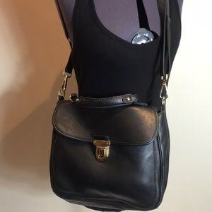 Roots black leather bag.